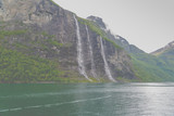Waterfalls pouring their waters to the Geiranger Glacier in Norway