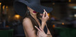 Quadro Sexy brunette woman with red lips in hat indoor, sensuality