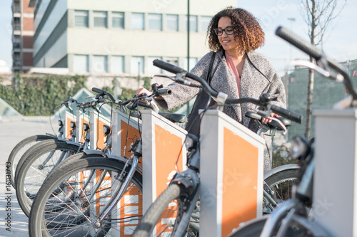 Afro american woman taking a bicycle