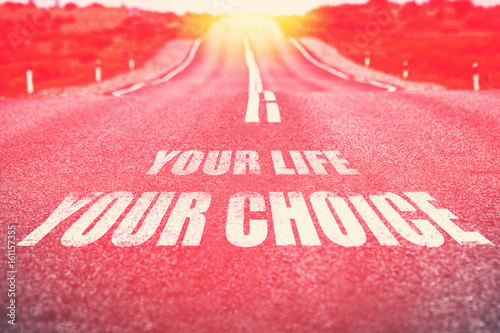 .Your Life Your Choice written on road. Selective focus. Toned. Poster