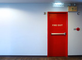 Fire exit emergency door red color and LED light made by metal material for protect life when in case of warning alarm sound in the building
