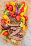Beef Fajitas with colorful bell peppers on a table