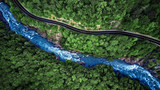 Fototapety Aerial view of Mountain river and road. Mountain gorge