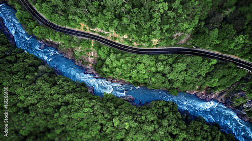 Aluminium Bergrivier Aerial view of Mountain river and road. Mountain gorge