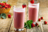 Delicious fruit milkshake made of fresh ripe strawberry and milk. Diet drink for healthy breakfast.