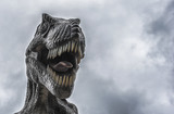 Tyrannosaurus with gray clouds background