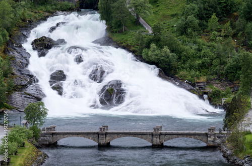 Hellesyltfossen, a waterfall that divides the village of Hellesylt (Norway) into two parts and is ranked as popular tourist attraction. - 161278736