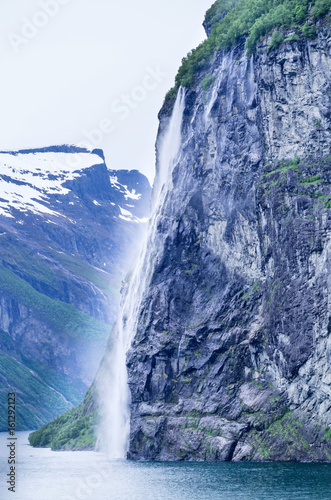 Seven Sisters, the 39th tallest waterfall in Norway. The waterfall consists of seven separate streams and the tallest of the seven has a free fall that measures 250 meters. - 161292123