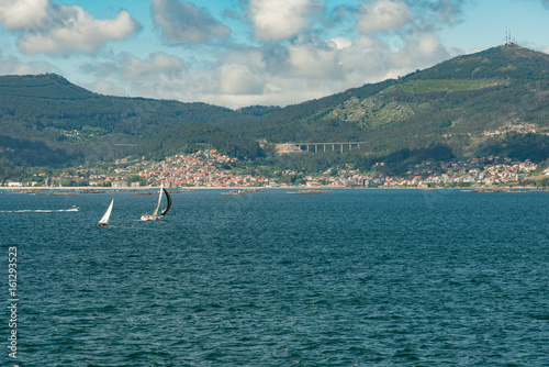 View from the sea of Vigo, Spain with mussel farms, sailboats and copy space
