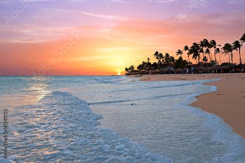 Plagát Druif beach at sunset on Aruba island in the Caribbean sea