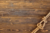 Rope knot on wooden board - 161437916