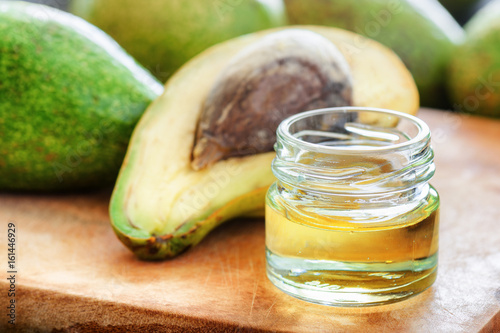 Closeup view of natural avocado oil on wooden board