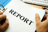 Folder and papers with title report. - 161455375