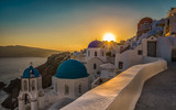 Sunset above blue dome churches in Santorini, Greece. Cyclades Island - 161466526