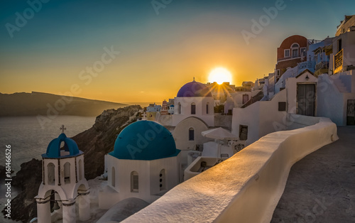 Sunset above blue dome churches in Santorini, Greece. Cyclades Island