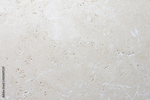 Foto op Canvas Stenen Beige stone background, natural travertine texture close up