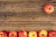 Red apples on the old wooden table. - 161498940