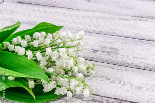 lily of the valley on wooden background with copy space