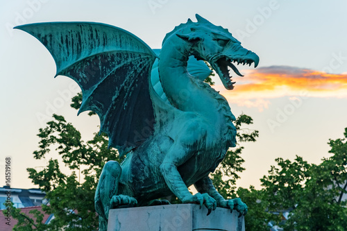 Green dragon breathing fire on Dragon bridge in Ljubljana