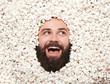 Expressive man posing in popcorn