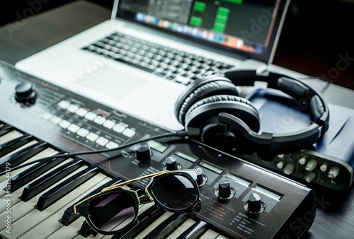 Computer Music Studio equipment with sunglasses on synthesizer - 161544179