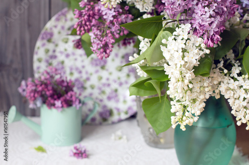 Vase with lilac bouquet.