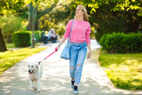 Woman enjoying park with dog - 161557524