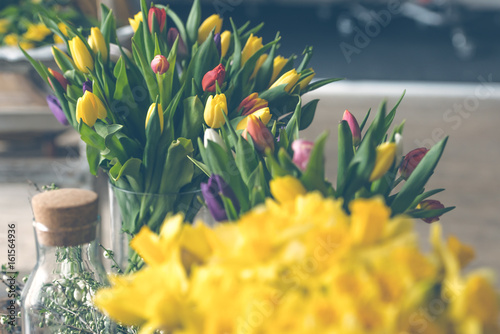 Yellow narcissuses bouquet in a glass vase