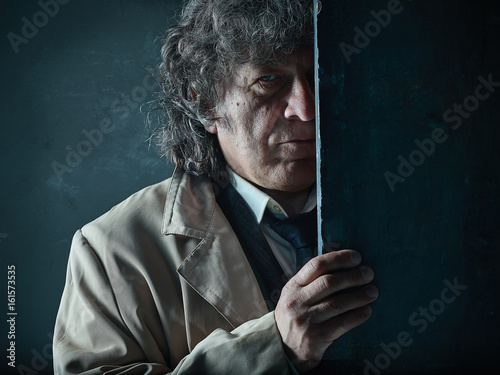 Poster The senior man as detective or boss of mafia on gray studio background