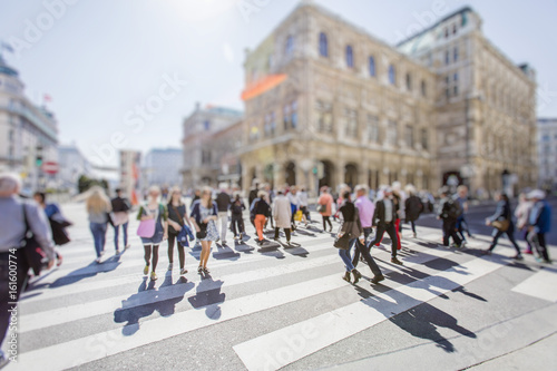 Poster Crowd of anonymous people walking on busy city street