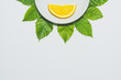 Minimal orange slice background. Fruit on white plate with leaves around it. Matte colored - 161610522