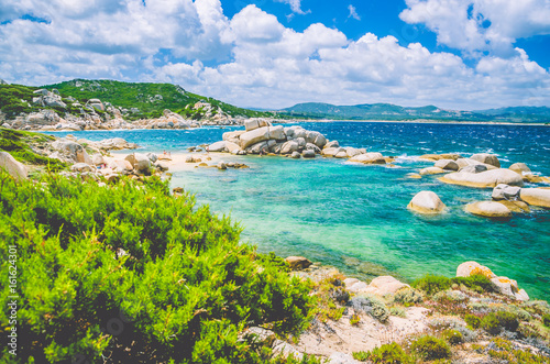 Fotobehang Eilanden Costline of Costa Serena with sandstone rocks in sea, Sardinia, Italy