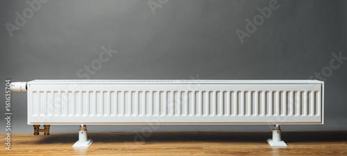 Leinwandbild Motiv heating radiator on grey background