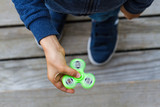 Kid playing with popular fidget spinner toy. Top view - 161657338