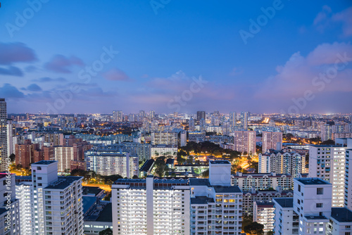 Foto op Canvas Canada Public residential condominium building complex at Toa Payoh neighborhood in Singapore, downtown skylines are in background. Aerial view at blue hour.