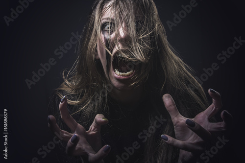 Crazy deranged woman pulling her hair out, scary and insane, halloween concept, Poster