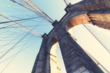 Brooklyn Bridge: brick tower arch viewed from bridge