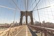 Brooklyn Bridge: skyline viewed through tower arch from bridge walkway
