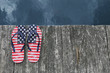 Flag flip flops on dock