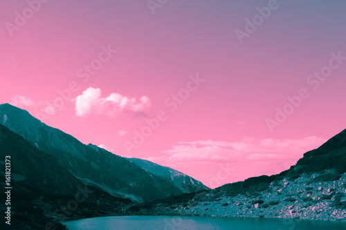 Aluminium Candy roze Beautiful view on the high green mountains peaks, on the colorful sunrise sky background. Mountain hiking paradise landscape, no people.
