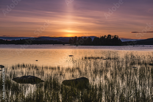 Sunset on the lake in Northern Sweden. Poster