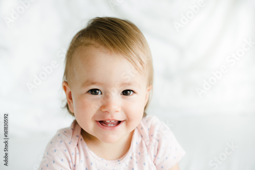 Beatiful baby girl smiling in bed