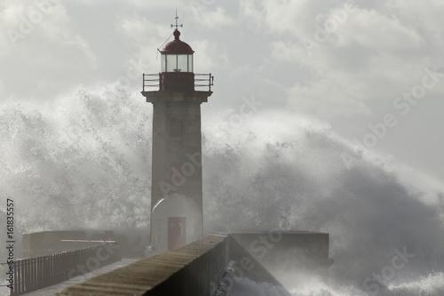Big wave against lighthouse