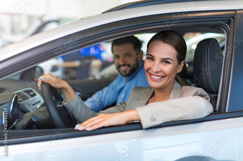 Young couple sitting in a car