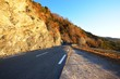 Close up of a mountain asphalt road in french alps near lac de Serre-Poncon. Ecrins massif
