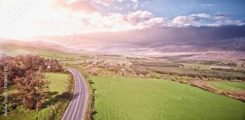 Foto op Canvas Lichtroze High angle view of road amidst grassy landscape