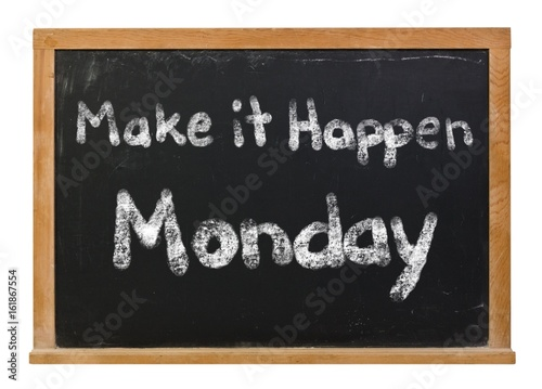 Make it happen Monday written in white chalk on a black chalkboard isolated on white