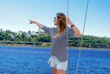happy overjoyed woman on a boat. summer trip on a yacht