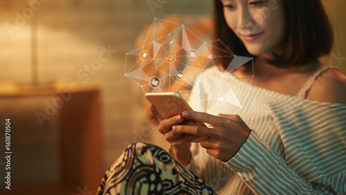 Pretty Asian woman in pajamas texting with her friend on mobile phone while enjoying peaceful evening at home, collage
