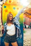 Young woman having fun in amusement park